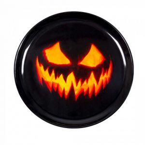 Musta tarjotin kurpitsan kasvoilla Halloweeniksi